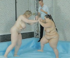 Sex-crazed chicks with massive plump bodies fuck after wrestling each other