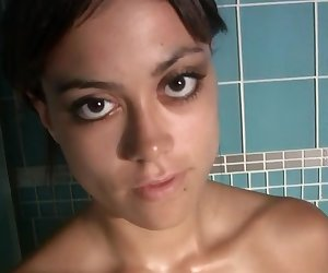 Petite brunette solo scene in the shower