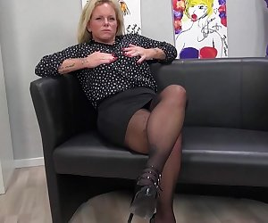 Naughty German housewife playing with her pussy