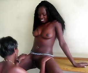 2 Horny amateur African lezzies fuck