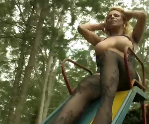 Blonde tranny with massive boobs and ass jerks off outdoors
