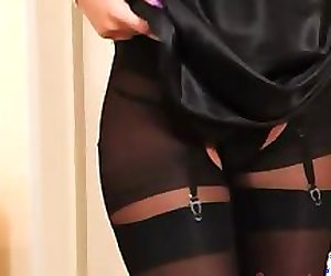 Blonde model in nylons teasing for a cam