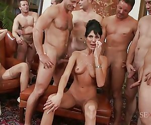Blonde and brunette sluts are Jizzed all over by a group of