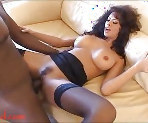 eightys hair style MILF with big tits goes for negro cock